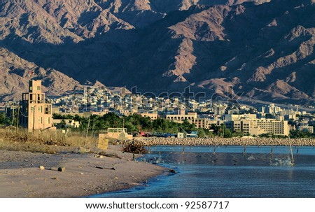 View on the border between Eilat (Israel) and Aqaba (Jordan) cities, both located on the northern beach of the gulf of Aqaba, Red Sea - stock photo