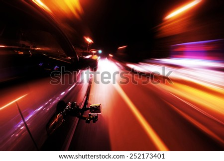 View on the camera recording from Side of Car Going Around Corner, Blurred Motion - stock photo