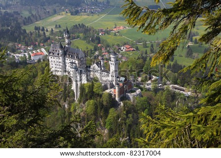 View on the castle of Neuschwanstein and its bavarian landscape. - stock photo