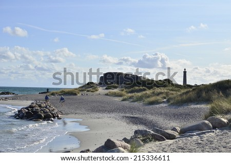 View on the coast in Skagen with the lighthouse - stock photo