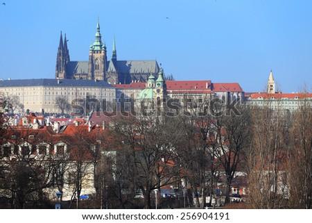 View on the colorful autumn Prague gothic Castle above River Vltava, Czech Republic - stock photo