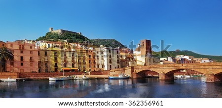 View on the colorful houses in Bosa, small town in Italian Sardinia - stock photo