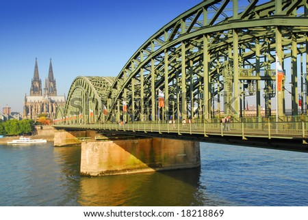 View on the 'dom' cathedral and the 'hohenzollern' railway bridge over river rhine in Cologne, Germany - stock photo