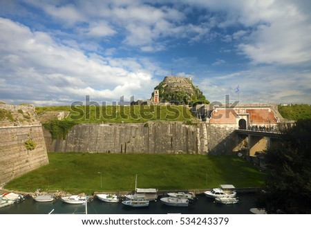 View on the entrance bridge and the weather station in Corfu fortress across the moat