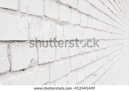 View on the facade of the old white brick wall  - stock photo