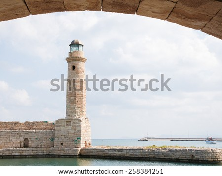 View on the famous lighthouse in the city of Rethymno on the island of Crete, Greece. - stock photo