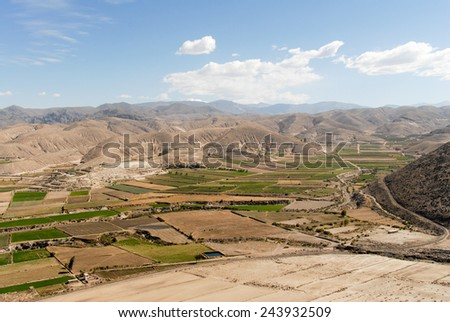 View on the field terraces in Peru, Colca canyon. the secend wolds deepest canyon at 3191m. The canyon is set among high volcanoes and ranges from 1000m to 3000m where life the Condor. - stock photo
