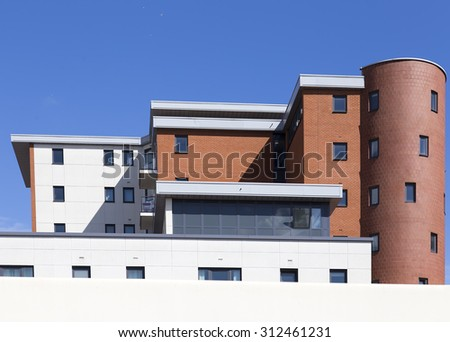 view on the generic red brick office building - stock photo