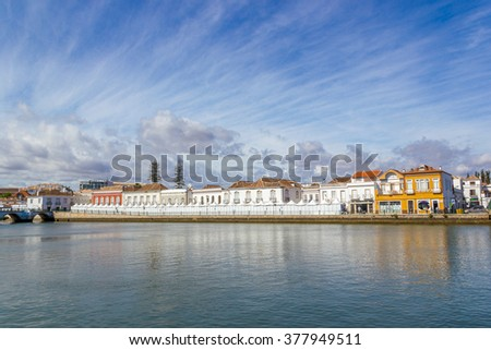 View on the Gilao river in Tavira municipality with blue cloudy sky, Portugal - stock photo