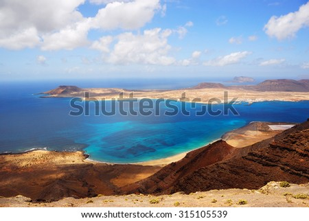 View on the Graciosa island from the high coast of Lanzarote - stock photo