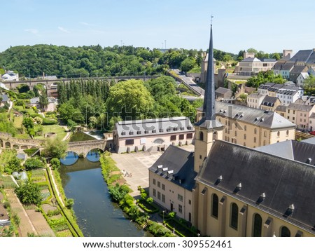 View on the Grund district of Luxembourg City with Neumuenster Abbey and Alzette river