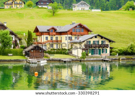 View on the lakefront of the city of Sankt Wolfgang, Austria, as seen from lake Wolfgangsee - stock photo