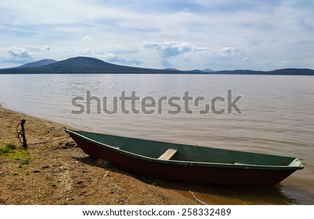 View on the mountains Lukash and Nurgush from the shore of Lake Zyuratkul, Southern Urals, Russia - stock photo