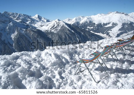 View on the mountains. Relaxing chairs near cabin. - stock photo