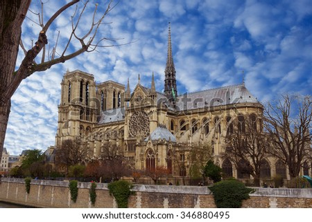 View on the Notre Dame De Paris over the beautiful dramatic blue sky, France - stock photo
