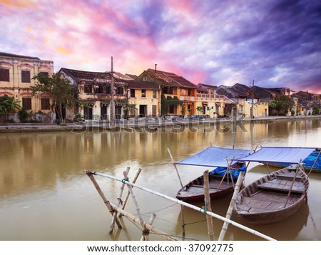 View on the old town of Hoi An from the river. Boats in the foreground. - stock photo