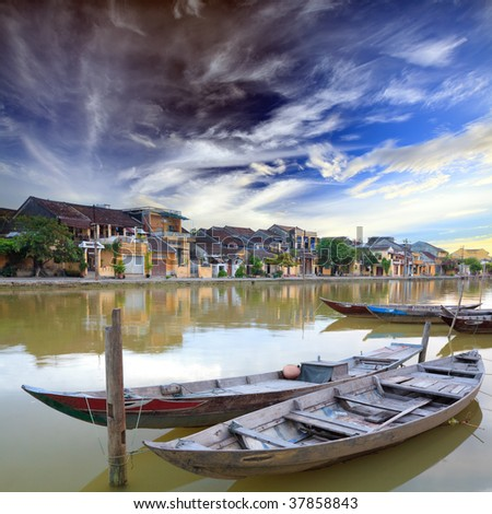 View on the old town of Hoi An from the river. Boats in the foreground. Vietnam - stock photo