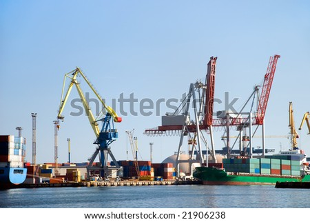 View on the port with loading cargo ship - stock photo