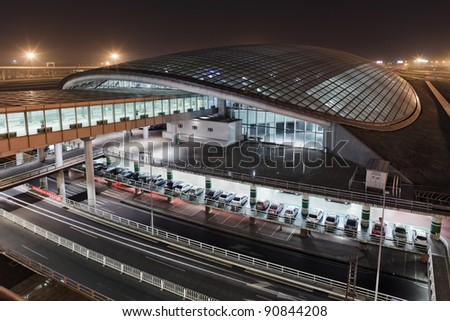 View on the railway station at Beijing Capital Airport Terminal 3 at night - stock photo