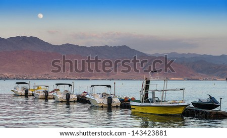 View on the Red Sea from central beach of Eilat - famous resort and recreation city in Israel - stock photo