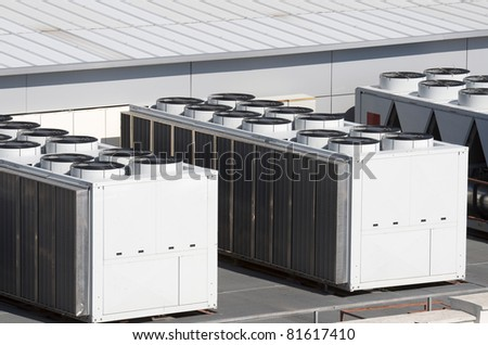 view on the roof of a building of a large air conditioning equipment - stock photo