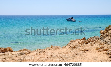 View on the sea with blue water and a yacht.