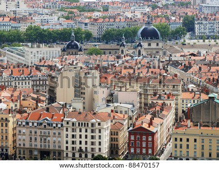 View on the tenement houses roofs and chimneys with Hotel Dieu hospital in Lyon, France - stock photo