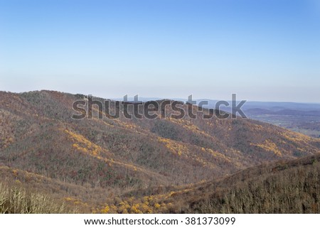 View on the valley hills. Late autumn naked trees. Beautiful scenery - stock photo