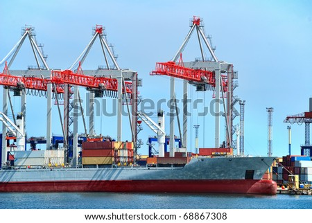 View on trading seaport with cranes, cargoes and the ship - stock photo