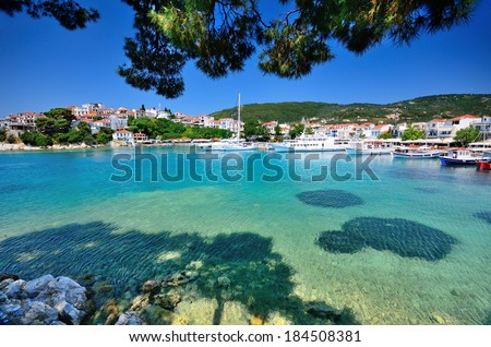 View on traditional greek town with whitewashed houses on Skiathos island, Sporades archipelago, Greece - stock photo