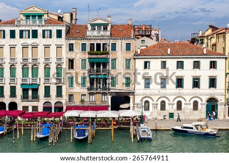 View on typical venetian buildings from the waterside of Grand Canal in Venice - stock photo