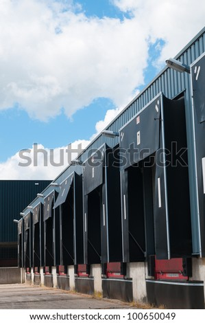 view on used row of loading docks - stock photo