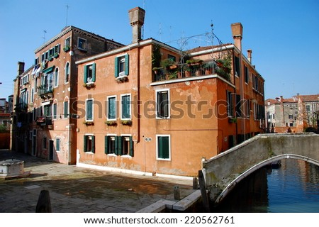 View on Venetian houses, canals, squares, palaces, boats, gondolas and gondoliers. Venice, Italy  - stock photo