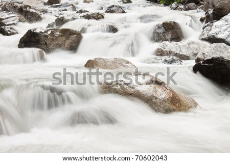 View on waterfall cascade in green forest - stock photo