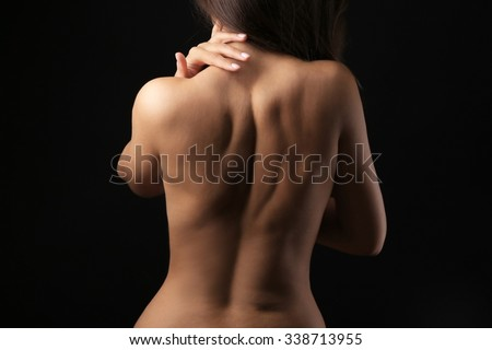 View on woman's nude back, close-up - stock photo