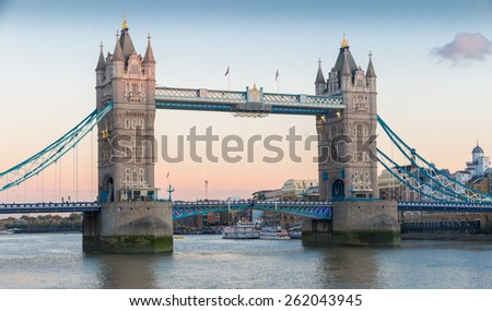 View on world famous London Tower Bridge shortly before sunset on a clear late summer evening - stock photo