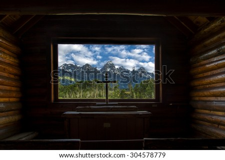 View out from the Chapel of the Transfiguration in Wyoming's Grand Teton National Park - stock photo