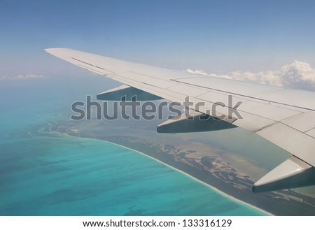 View out of airplane wing in flight