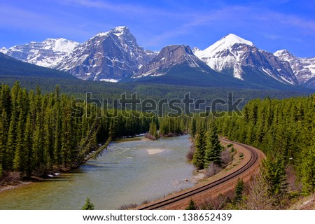 View over a river through the Rocky Mountains, Banff, Canada - stock photo