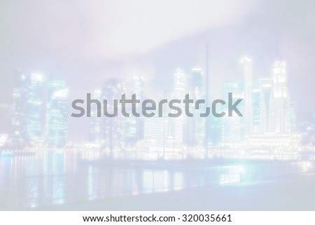 view over big asian city , metropolis at nighttime when the tall skyscrapers are illuminated - stock photo