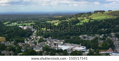 View over Bollington on the edge of the Peak District in the heart of England. Old converted cotton mills can be seen in the town - stock photo