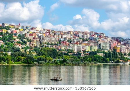 View over buildings situated on the shore of golden horn in istanbul. - stock photo