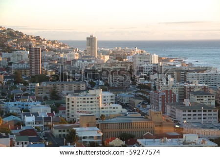 View over Cape Town, South Africa, at dawn with the harbor in the background. - stock photo