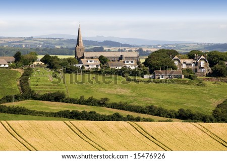 view over devon countryside with fields and farmland - stock photo