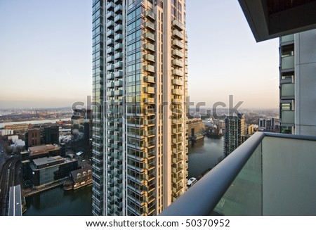 view over docks of London and buildings from a high rise tower - stock photo