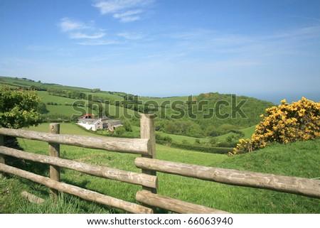 View over fields on Porlock Hill, Exmoor - stock photo