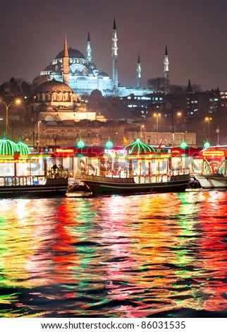 View over Golden Horn in Istanbul by night - stock photo