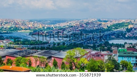 View over halic bridge in istanbul from the top of city wall ruins - stock photo