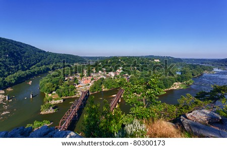 View over historical civil war town of Harpers Ferry, a National Park owned town, by the confluence of the Potomac and Shenandoah rivers - stock photo