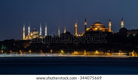 View over illuminated blue mosque and hagia sophia from opposite side of istanbul. - stock photo